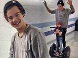 Segway fiend: Harry Styles scoots around on a Segway backstage at the One Direction concert