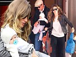 Little huggy bear! Gisele Bundchen and Tom Brady keep their baby girl Vivian cosy in whimsical knitwear on family outing