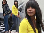 Similar style: Michelle Williams, left, and Kelly Rowland, right, both wore skinny jeans and sky-high pumps as they arrived at Bagatelle restaurant in West Hollywood, California on Sunday
