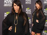 Hired a new stylist? Kim Kardashian rocks the red carpet in stylish black as she leads the way at MTV Movie Awards