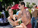 Double dare: Dallas hunk Jesse Metcalfe and his bikini-clad fiancée Cara Santana opted to skip the crowded concert to make a spash poolside at the Guess soiree Sunday