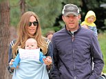 Family day out: Guy Ritchie and girlfriend Jacqui Ainsley enjoyed a causal stroll with their daughter in Beverly Hills on Sunday afternoon