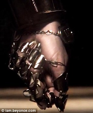 Spinning around: Beyonce dons a cybernetic hand for the short video