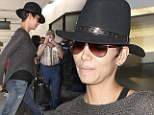 Baby, let's fly! Jet-setter Halle Berry wears comfy knit top as she jets out again