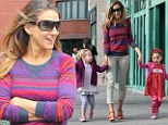 Well, she is a fashionista after all! Slender Sarah Jessica Parker colour co-ordinates her and her twin daughters' outfits for regular school run