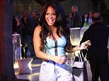 At least she's happy: Christina Milian was seen in very ripped trousers heading to the Lakers game on Wednesday