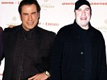 Look who's not porking! John Travolta is back to his hip swivelling best as he shows off newly slim frame in fitted suit