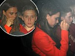 Stepping into David's shoes: Victoria Beckham leaves Nobu arm in arm with her eldest son Brooklyn after day of birthday fun