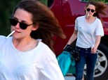 Out of puff! Kristen Stewart takes out the trash with unlit cigarette hanging out of her mouth