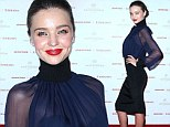 Under wraps... for now: Miranda Kerr shows a hint of her former Victoria's Secret body in sheer top at gala dinner