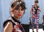 Flower power! Kourtney Kardashian pushes the fashion envelope in matching floral trousers and jacket