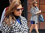 Check mate! Eva Mendes gets it right in the style stakes in navy and white coat as she leaves her hotel