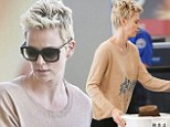 Getting there! Charlize Theron shows off her growing locks as she flies out of Los Angeles