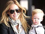 My son-shine: Hilary Duff beamed as she held her one-year-old son Luca Cruz snugly in her arms on Wednesday morning in Sherman Oaks, California