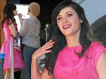 Pretty in pink! Quirky Zooey Deschanel goes all girlie as she films new music video in Los Angeles