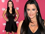 What a waist! Kyle Richards, who recently admitted to having liposuction around her midsection, showed off her figure at a party in LA on Thursday