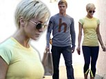 Danger zone: A serious looking Kellie Pickler practically screams danger zone in a black-and-yellow outfit as she left DWTS rehearsals with partner Derek Hough on Thursday
