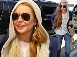 That's not a very good disguise! Lindsay Lohan attempts to go incognito in a hoodie and sunglasses as she jets to New York