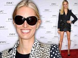 You can't blame her! Karolina Kurkova shows off her endless legs in a tiny skirt... hours after dressing them in spray-on jeans