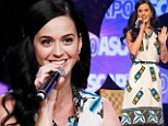 Waiting for someone to call? Katy Perry shows her quirky side in dress covered in cell phones