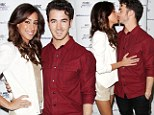 Married and loving it! Kevin and Danielle Jonas share a passionate kiss as they celebrate show's second season premiere