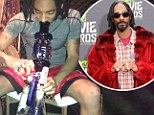 Following in his father's smoke rings: Snoop's teenage son posts pictures of himself using marijuana