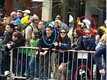 Moments from death: This chilling image shows one of the Boston bomb suspects standing right behind eight-year-old victim Martin Richard (ringed, left) moments before the explosion