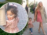 'She's a diva in training': Mariah Carey and adorable daughter Monroe step out in pink dresses as singer heads to American Idol
