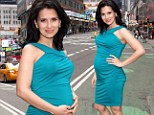 No wonder she was picked! Hilaria Baldwin looks lovely in tight teal dress after being named second best-dressed pregnant star