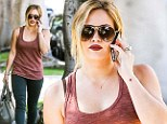 The lady is a vamp! Hilary Duff spices up her girl next door look with gothic blood red lipstick
