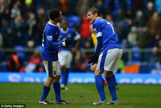 Frustration: Steven Pienaar and Nikica Jelavic of Everton argue at half-time