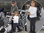 Quite the cool traveler! Son Mason steals the show from birthday girl Kourtney Kardashian as he glides through the airport on skateboard