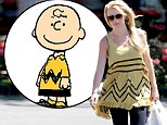 Getting animated! Britney Spears channels Snoopy cartoon Charlie Brown in a yellow and black striped dress