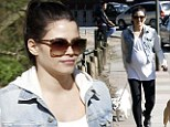 Bumping along nicely: Pregnant Jenna Dewan gets some gentle exercise as she walks her dogs in the park