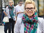 Do ya think I'm specsy! Sports Illustrated model Jessica Hart dons glasses and dowdy ensemble for New York outing