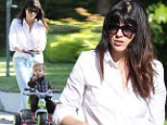 A little help from mum! Selma Blair gently pushes 21-month-old Arthur along on his tricycle as the pair enjoy a sunny stroll