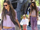Hippie chick Alessandra Ambrosio flashes her toned tummy in printed trousers as she takes a stroll with her flower child Anja