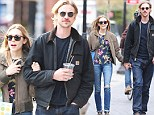 Blooming lovely: Elizabeth Olsen steps out in chic flowery top and skinny jeans as she enjoys a touchy feely stroll with her boyfriend