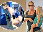 On the mend: Nicole Eggert steps out with her daughter as she denies being hospitalised after botched high dive