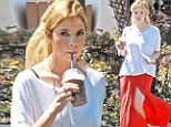 Spring has Broken! Ashley Benson ditches dark Coachella getup for a more summery look, stunning in an orange flowing skirt