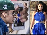 His blue belle: The star had a picture of Gomez from a photo shoot in March