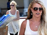 No frills spared! Britney Spears floats into spring with a pretty white ruffled top and black leggings