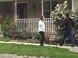 Convert: A woman believed to be Katherine Russell, the wife of Boston bomber Tamerlan Tsarnaev outside her family's Rhode Island home today.