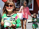 Mommy's little fashionista: Alessandra Ambrosio's daughter Anja stands out from the crowd in a green patterned dress