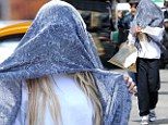 You can't see me! Amanda Bynes has a new idea for a disguise, covering her entire head with a blue scarf to avoid photographers