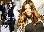 Got some rest on the flight! Radiant Liv Tyler totes trusty travel pillow through LAX