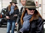Who's under the hat and sunglasses? Carla Bruni-Sarkozy steps out in Paris wearing full disguise