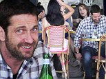Nevermind me: Hollywood leading man Gerard Butler dined alone on Monday next to an animated gaggle of women in Los Angeles