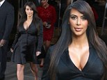 Busting out... again! Pregnant Kim Kardashian takes the plunge in a satin tuxedo-style coat dress as she heads to E! red carpet event with her family