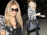 No maternity wear for her! Pregnant Fergie sports leather trousers and high heels to catch a flight